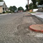 A road after being milled and prepared for overlay of new asphalt.