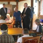 Attorney General candidate Warren Tolman and Middlesex Sheriff Peter Koutoujian speak at a senior living facility in Waltham.