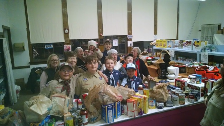 St. Vincent de Paul's Food Pantry Volunteers from the Boy Scouts (left to right): Jonathan Fujiwara, Daniel VanRyn, Ben VanRyn, Edward Hammonds, Jayne Popiel, Ellen Dupuis, Maureen Henry, Mary Fujiwara, Peggy Little (Food Pantry Coordinator), James Munroe-Ellis, and Dorothy Brown.