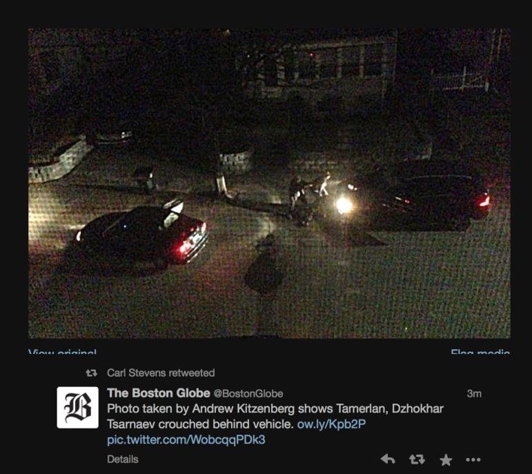 A photo taken by Laurel Street resident James Floyd of the Tsarnaevs crouching behind the Mercedes SUV during the shootout with Watertown Police, via the Boston Globe's Twitter feed.