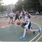 Players clash on the Saltonstall Park basketball court during the Watertown Summer Basketball League playoffs.