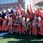 The 2015 Watertown High School field hockey team celebrates winning the state championship - the team's seventh straight.