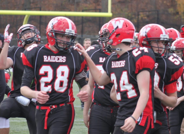 Watertown sophomore Conor Kennelly, left, is congratulated by junior Ryan Barry for hitting the game winning field goal against Belmont.