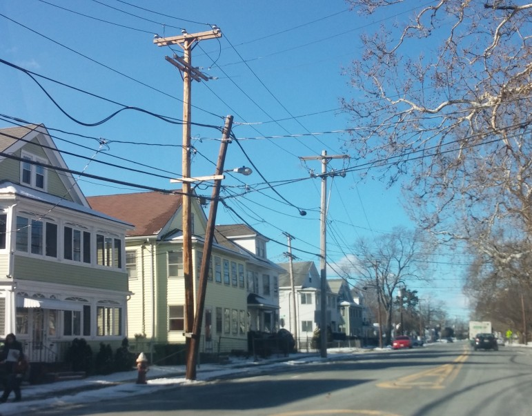 An example of a double utility pole on Main Street in Watertown
