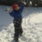 """4-1/2 year old Jack plays in the snow making """"snow confetti"""" during Monday's storm."""