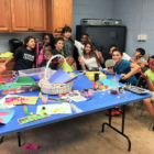Watertown Boys and Girls Club members in the Multi-Purpose Room having fun with face painting and arts and craft projects.