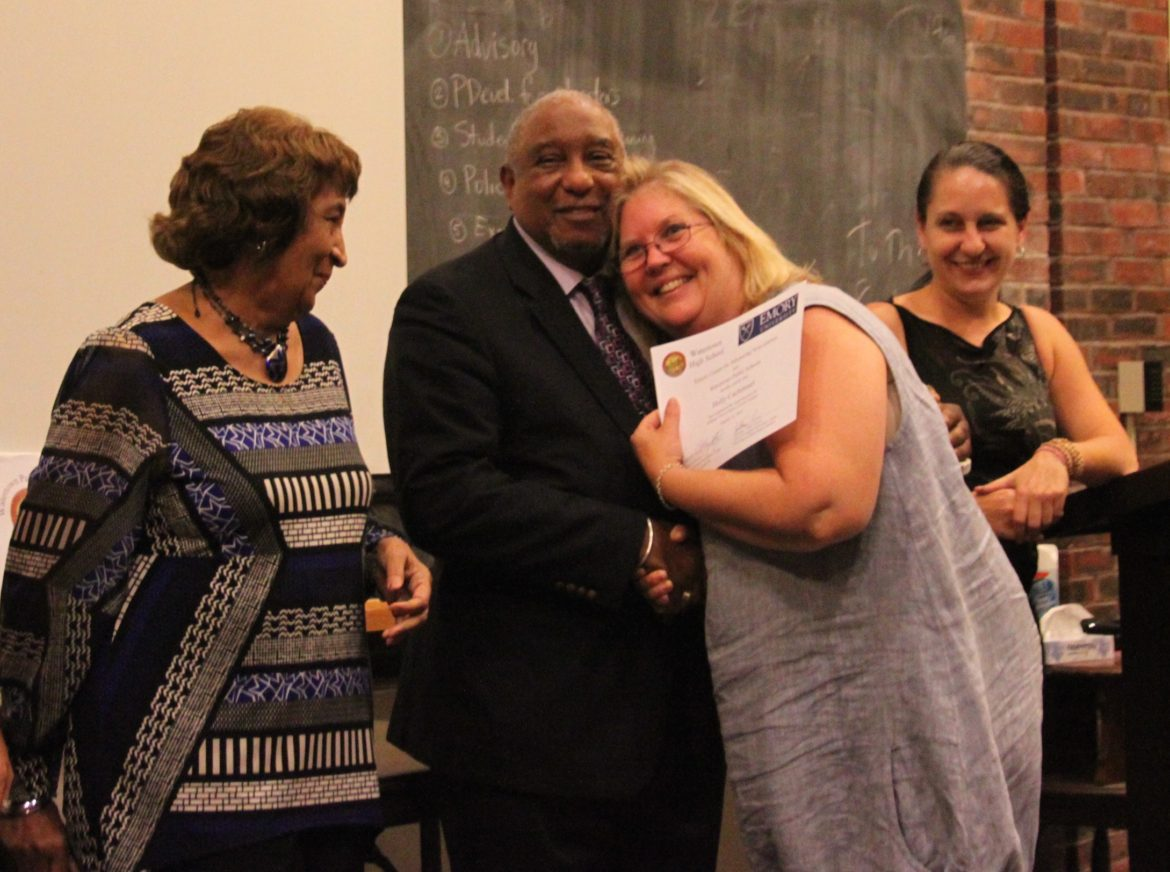 Watertown Middle School Spanish teacher Holly Cachimeul hugs Dr. Bernard Lafayette after she completed her training in Kingian Nonviolence, as Kate Lafayette (left) and WMS Spanish Teacher Ruth Henry (right) watching. Cachimeul and Henry brought the program to the Watertown Public Schools.