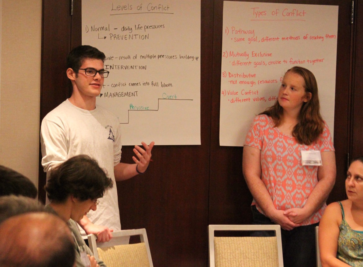 Watertown High School junior Michael Teeven teaches the teachers during the Kingian Nonviolence training on Thursday as fellow trainer and WHS history teacher Erin McGovern looks on.