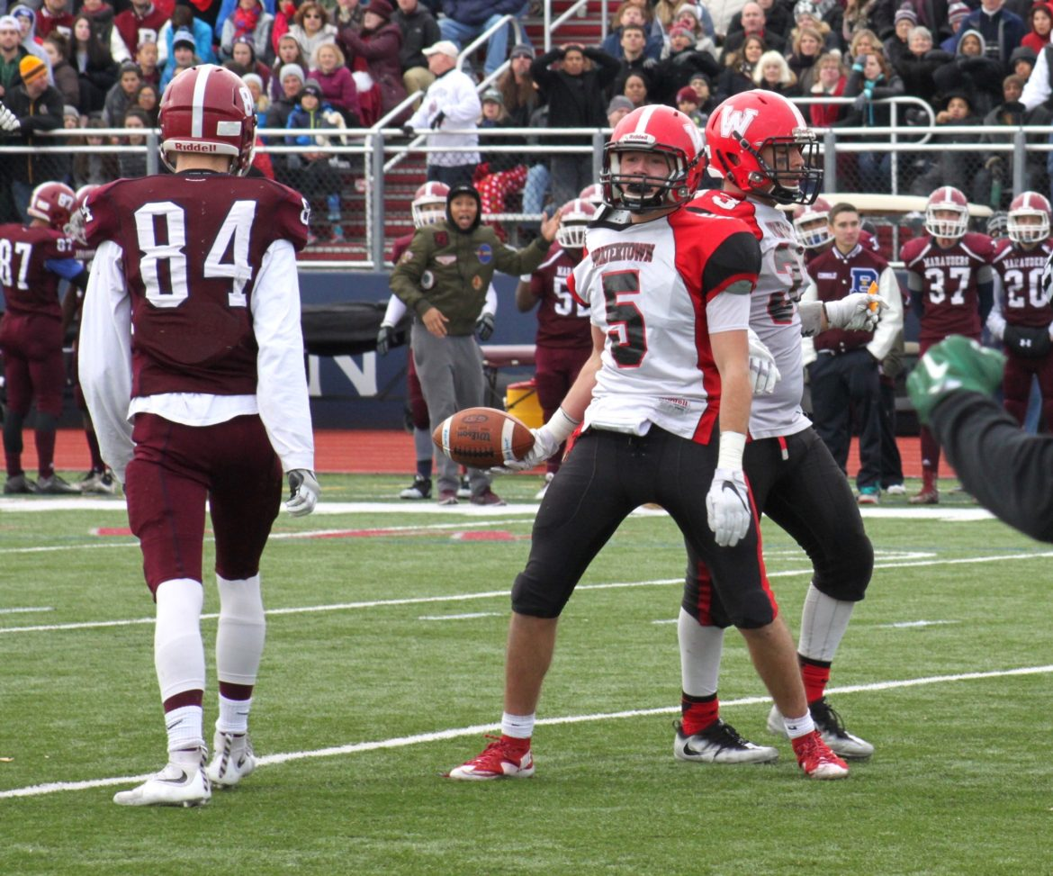 Watertown junior Isaac Huff celebrates after making the game clinching interception against Belmont.