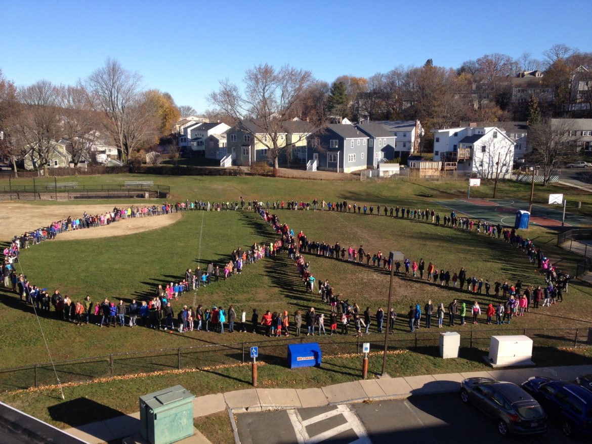 The entire student body and staff of Lowell School created a giant Peace sign in front of the school the day before Thanksgiving.